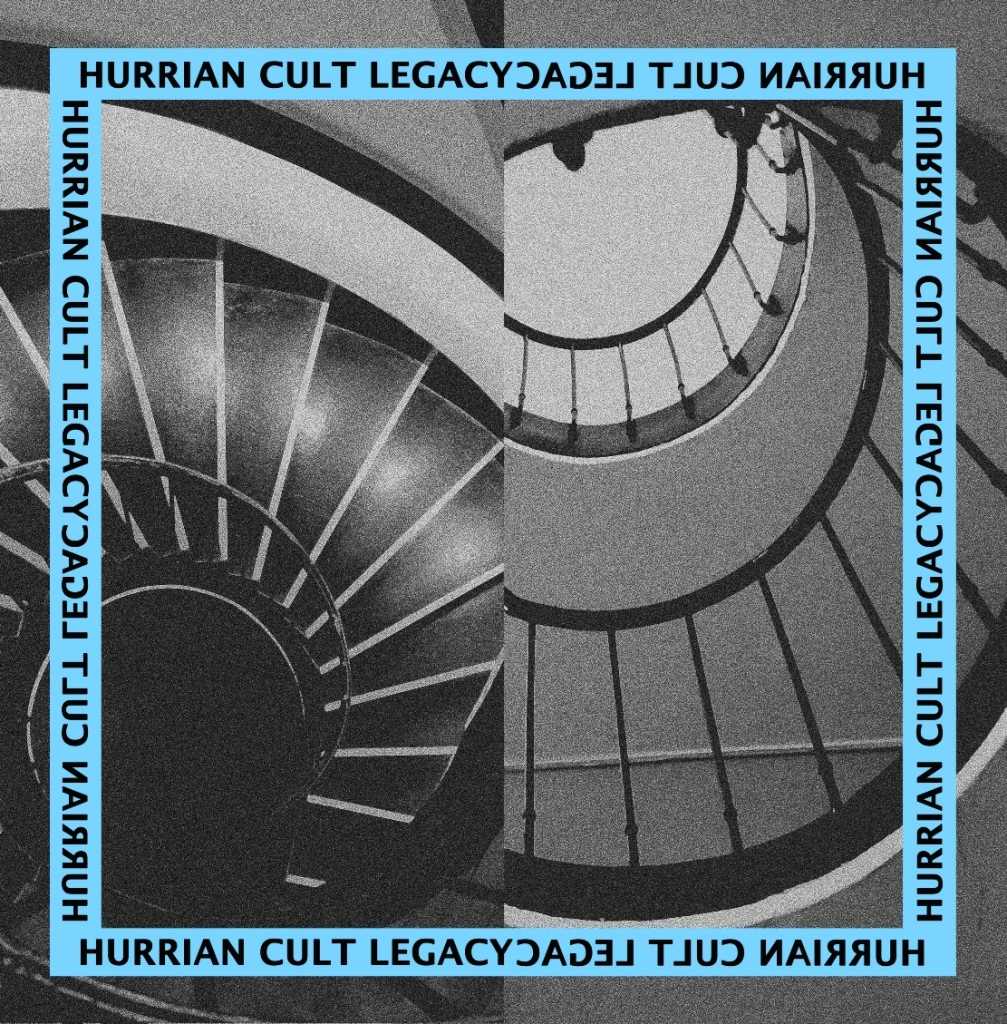 An image divided in two, one side with a black spiral staircase, the other with a grey spiral staircase, curling like snail shells with a light blue border.